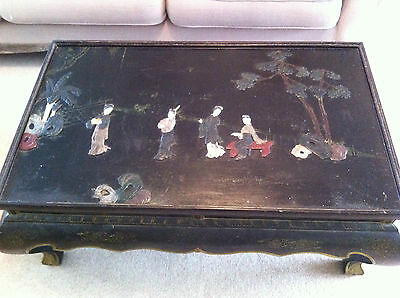 Exquisite carved chinese table depicting ladies at leisure