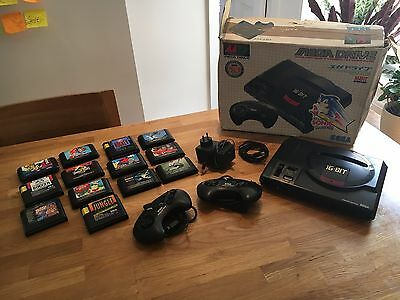 Sega Mega Drive Black Console (PAL) with 13 games.