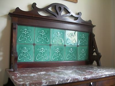 wash stand with art nouveau green tiles