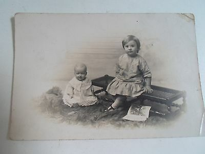 Vintage RPPC Cute Little Girl With Old Doll Seaman's Studios Hull + Beverley