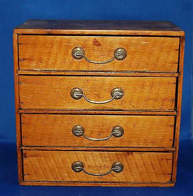 A miniature set of four drawers, ideal for jewellery, collectables, postcards