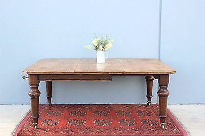 Antique Farmhouse rustic  Oak Dining Table. With extender leaf & hand crank.