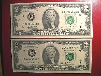 Two American banknotes are $2 bank note USA years 1995 and 2003A