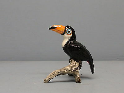 Retired Hagen Renaker Toucan on Stoneware Branch Blue Eyes Black Feet