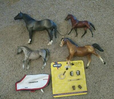 Lot of 4 breyer horses medium and large sizes and accessories