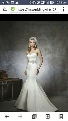 Wedding Dress size 10, unaltered, new with tags