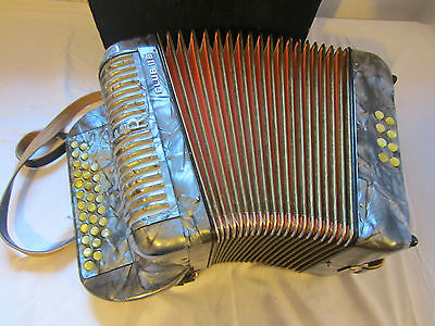 an older Harmonica Hohner Club II B with case