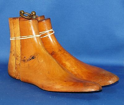 A pair of antique Victorian solid wood three part boot trees, about sz 7-8