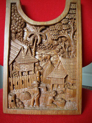 Oriental Intracate Hand Carved Wooden Plaque In A Good Condition