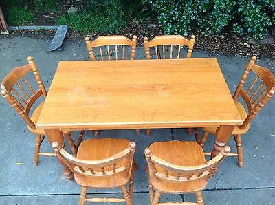 Timber dining table and 6 chairs