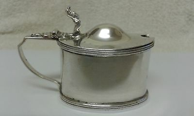 An Oval Silver Mustard Pot, Chester 1920, with Blue Glass Liner.