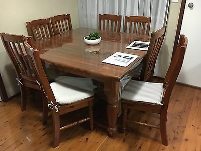 Solid oregon timber dining table and 8 chairs