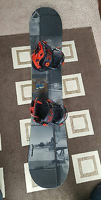 Burton snowboard with quick release SP bindings