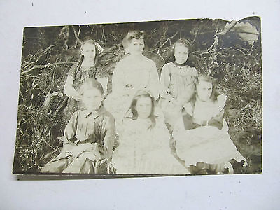 Real old photo postcard of a Mother and group of young women