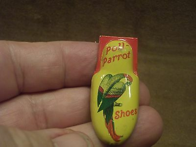Vintage Poll-Parrot Shoes Tin Clicker Toy
