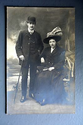R&L Postcard: Portrait of Unknown Edwardian Lady & Gent Greats Hats, Sheffield