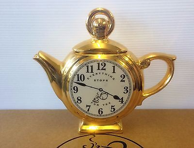 1 cup gold pocket watch  teapot by swineside aka teapottery