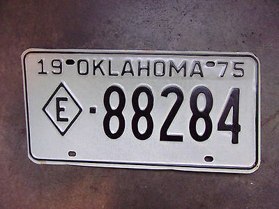 "NOS Vintage Old License Plate Sign Oklahoma 1975 ""E"" Tag Man Cave Tax Exempt"
