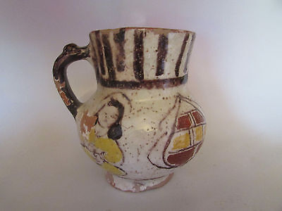 Nice antique Islamic glazed terracotta jug