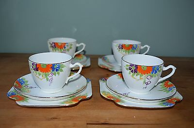 Pretty Art Deco 'Grafton' Hand Painted Tea Cups, Saucers and Side Plates c1930s.