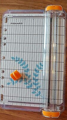 Fiskars 9inch swing arm papercutter. with new blade.