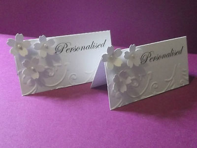 90 Personalised wedding table place cards with 3 flowers and embossed edge