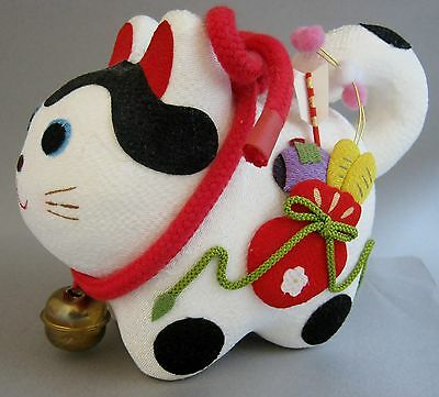 Japanese Lucky Guardian lion-dog wearing a Bell processed with chirimen fabric