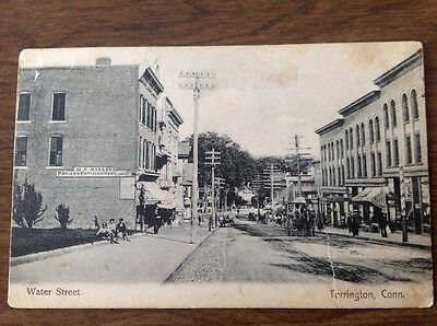 Torrington CT Dirt Water Street Store Fronts Postcard. Made in Germany 1905?.