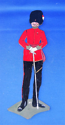 A very unusual vintage wooden hand cut and painted Guardsman soldier figure
