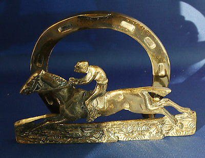 An antique Victorian brass racehorse and jockey letter rack, horse racing