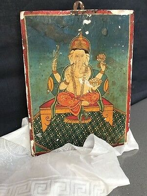 OLD SACRED THANGKA of FOUR ARMED GANESHA. HAND PAINTED, WOOD. KATHMANDU, NEPAL.