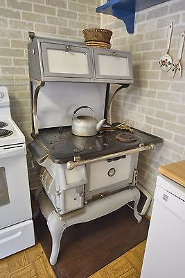 "Windsor antique wood cook stove with 2 8"" warming ovens."