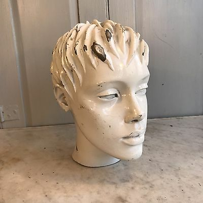 Vintage retro female mannequin head with short pixie hairstyle