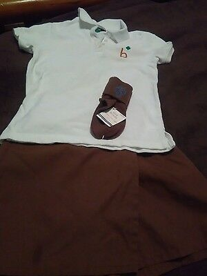 OFFICIAL GIRL SCOUT BROWNIE SKORT & POLO & PAIR OF SOCKS..size small 7/8