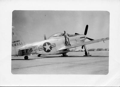 Vintage Black & White Snapshot of a P-51 Mustang Fighter Plane and Its Pilot