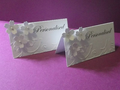 50 Personalised wedding table place cards with 3 flowers and embossed edge