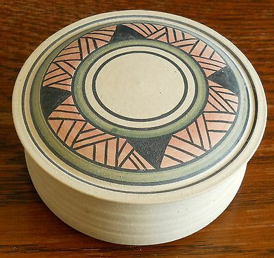 A Studio stoneware box with painted lid signed Douglas