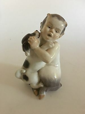 Royal Copenhagen Figurine of Faun with Puppy No. 2590