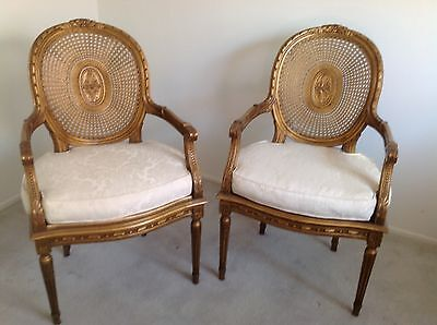 Louis XVI Carved Wood cane back Gold fireside arm chairs (set of 2) w/cushions