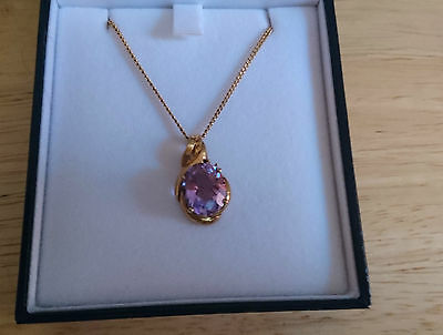9ct Gold Oval Amethyst Pendant with 2  diamonds