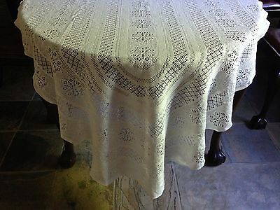 White crochet-lace oval table cloth