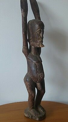 Old African wood Dogon Tellem figure from Mali.