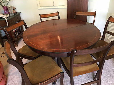 Round mahogany table and 6 chairs