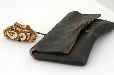 Japanese Stag Antler Netsuke and Tobacco pouch with great snail Menuki late 19C