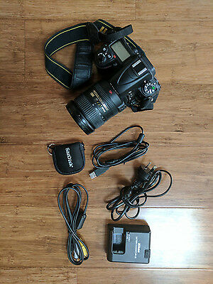 Nikon D7000 camera body with 18-200mm Nikkor lens. BONUS carry bag and SD card!!