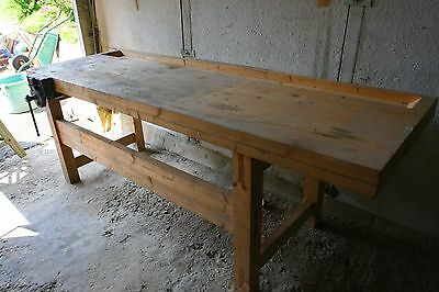 Large wooden work bench with vice.