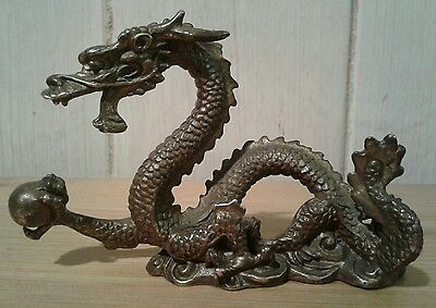 Antique / vintage chinese cast bronze dragon holding a lucky pearl