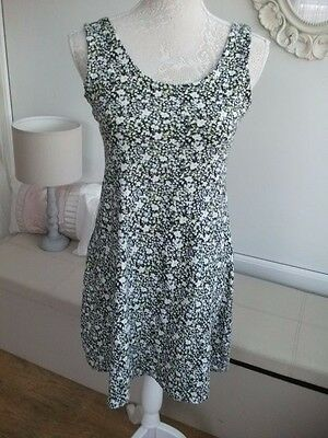 Ladies patterned dress with blacks,green, white size 14