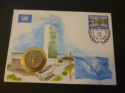 United Nations 1990 Coin Cover featuring a Kennedy Half Dollar dated 1985.