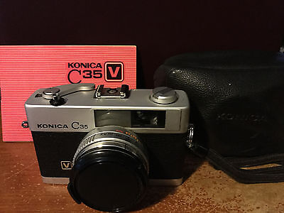 Konica C35 Camera w/ Soligor Filter, Case And Manual...Not Tested